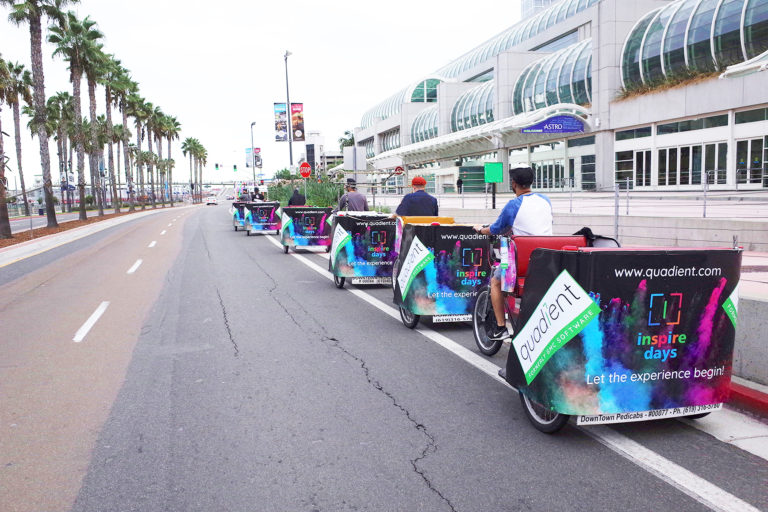 Quadient branded pedicabs