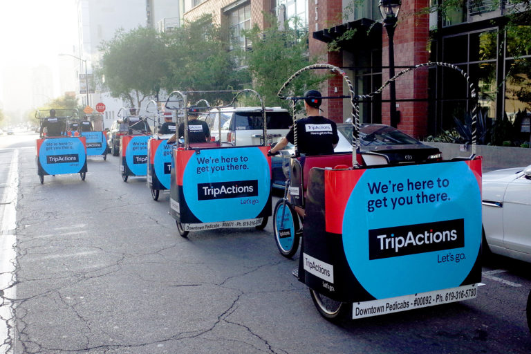 Trip Actions branded pedicabs