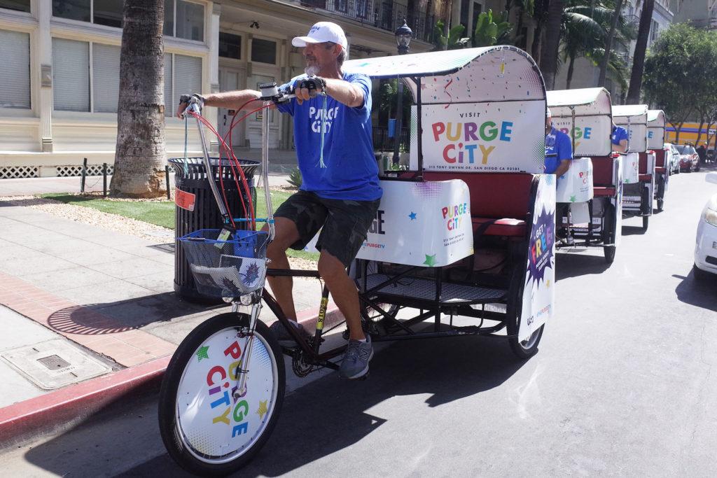 San Diego Pedicab driver riding pedicab